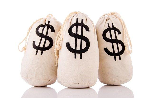 sacks full of money on white