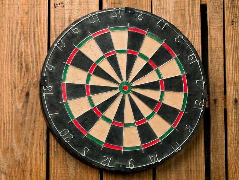 dart board on the wooden wall