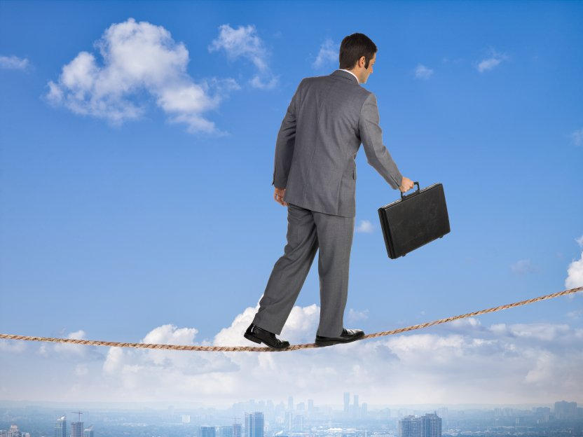 business man balancing on a rope