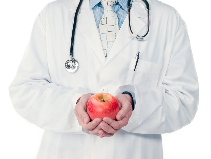cropped image of a doctor holding an apple